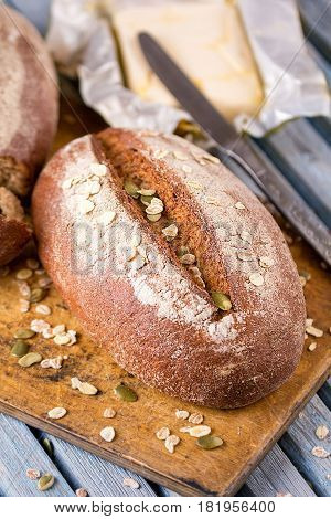 Fresh bread. Homemade traditional bread. Bread crumbs knife and butter