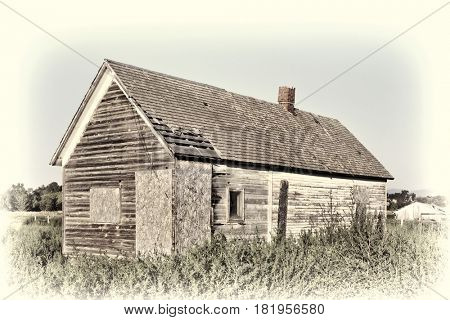 old abandoned farm house, boarded and overgrown by weeds, near Fort Collins, Colorado, retro hand tinted opalotype toning