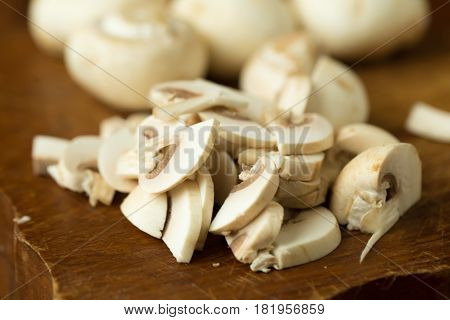 Champignon Mushrooms On The Wooden Table. Selective Focus