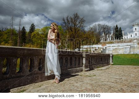 Outdoor Summer Portrait Of Young Pretty Cute Girl. Beautiful Woman Posing At Old Bridge.  In White D