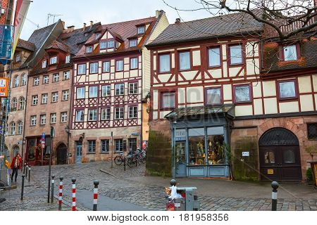 Nuremberg, Germany - December 24, 2016: City street of Nuremberg, Franconia with half-timbered houses in Bavaria
