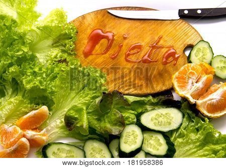 Composition With Fresh Organic Vegetables And Fruits And Cutting Board With The Translitiration Insc