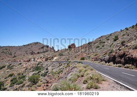 Mountain road to volcano Teide among rocky mountains on Tenerife island Spain