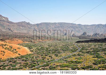 Mountain road to volcano Teide among rocky mountains on Tenerife island Spain