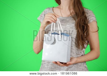 Girl Holding In Hand Blank Blue Paper Gift Bag Mock Up. Empty Package Mockup Hold In Hands Isolated.
