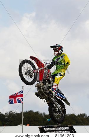 NEWBURY, UK - SEPTEMBER 21: An FMX stunt rider leaves the starting ramp at speed before completing a mid air stunt for the watching crowd at the Berks County show on September 21, 2014 in Newbury