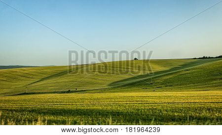 Bohemian countryside with mountain meadows and clear sky.