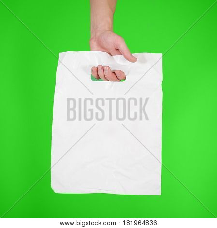 Hand Shows Blank Plastic Bag Mock Up Isolated. Empty White Polyethylene Package Mockup. Consumer Pac