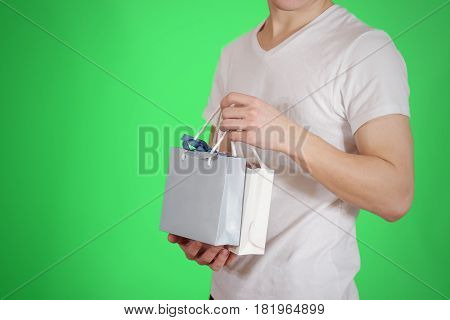 Man Holding In Hand Blank Two Paper Gift Bag Mock Up. Empty Package Mockup Hold In Hands Isolated. C