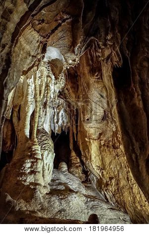 View of fantastic stalactite caves and wall relief.