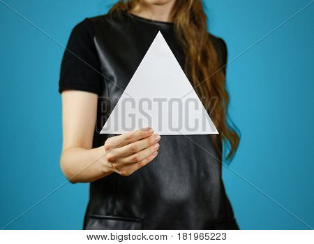 Girl Showing Blank White Triangular Flyer Brochure Booklet. Leaflet Presentation. Pamphlet Hold Hand