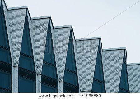 Facade of modern hi-tech building view on top floor