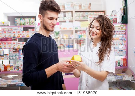 Woman doctor and her client in front of the shop. Healthcare business