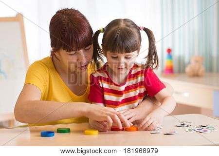 Cute child girl at speech therapist office