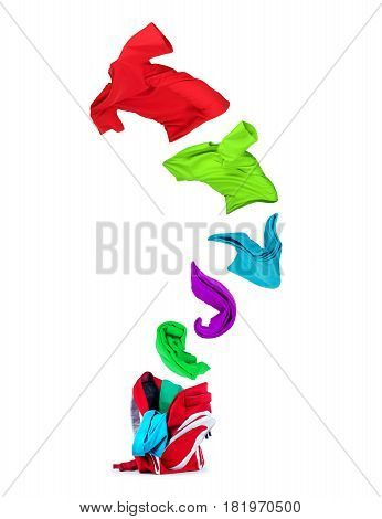 Multi-colored T-shirts fly out of the backpack isolated on white background