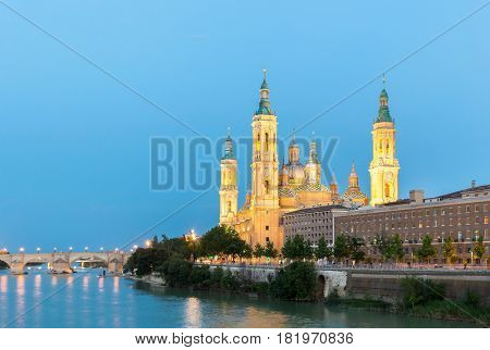 Our Lady of the Pillar Basilica with Ebro River at dusk Zaragoza, Spain