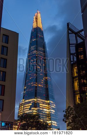 London UK - Octomber 4 2016: Lights on The Shard skyscraper at dusk as seen from London's More Riverside