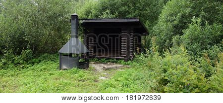 Public shelter for hikers with grill in Estonia