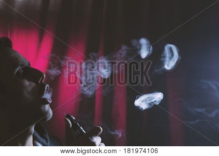 Young Man Smoking Electronic Cigarette Or E Cig.