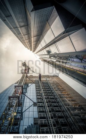 London, UK - March 29, 2017: The futuristic industrial looking Lloyds building in the City of London on a cloudy day