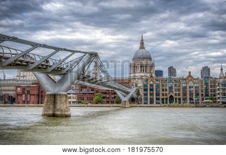 London, UK - August 8, 2016: The Millennium bridge and St Paul's cathedral on a cloudy day