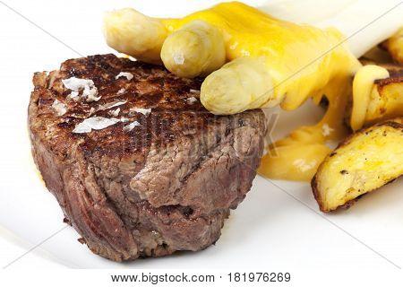 closeup of beef steak and asparagus with potatos
