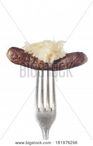 nuremberg sausage on a fork on white