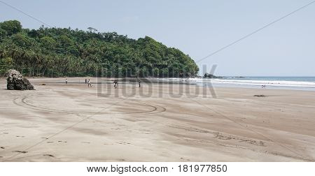 SEVEN WAVE BEACH, SAO TOME - JANUARY 29, 2017: Young men playing football on the Seven Wave Beach on January 29, 2017 in Sao Tome and Principe, Africa