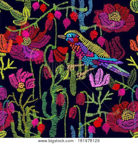 Seamless vector pattern with embroidered flowers, grass and birds. Vintage composition.