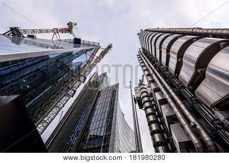 London UK - March 29 2017: The futuristic Lloyds building Willis tower and the Scapel skyscraper which is under construction in the City of London on a cloudy day