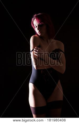 Sexy model in lingerie and leather jacket in studio photo on black background. Erotica and sensuality. Passion and fashion