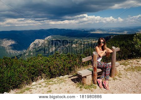Woman Travel And Relax  In Mountains