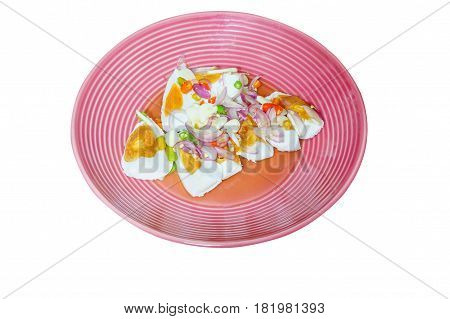 Thai food : spicy egg salad with shallots garlic and chili on pink dish. Top view. It isolated white background.