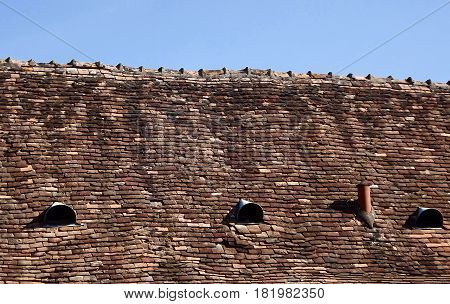 Ancient terracotta tiled roof in rural France