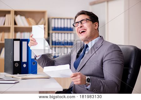 Businessman receiving letter in the office