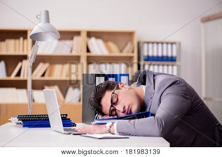 Sleepy businessman working in office