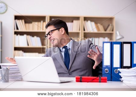 Businessman with dynamite in the office
