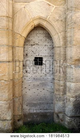 Ancient medieval door at Ste Severe in central France