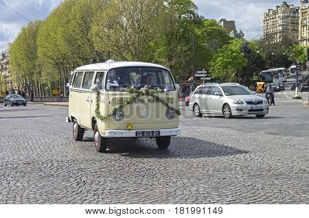 PARIS FRANCE - APRIL 1 2017: The legendary minivan Volkswagen Transporter T2b decorated for a wedding ceremony on a Paris street.