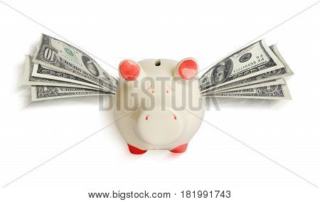 A white piggy bank with wings of paper dollars. The piggy bank is flying. Isolated on white background