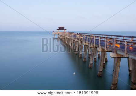 Fishing pier in Naples illuminated at dusk. Florida United States
