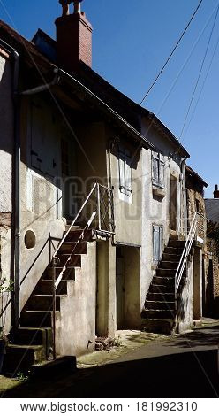 Old French house with external stairs in La Chatre, central France
