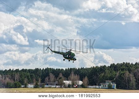 Belarus, Minsk - 15.04.2017: Helicopter MI-2 takes off from the ground airfield