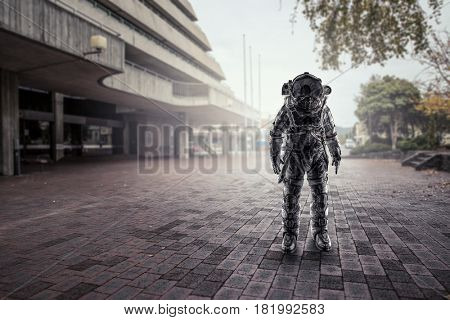 Astronaut that landed in city . Mixed media