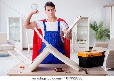 Superhero repairman with tools in repair concept