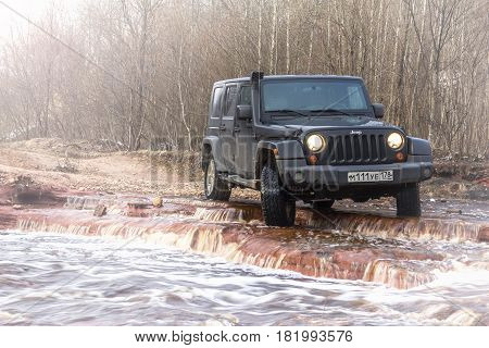 Leningrad region, Russia - April 16, 2017. Jeep Wrangler on the shore of the river Wrangler is a compact SUV produced by Chrysler