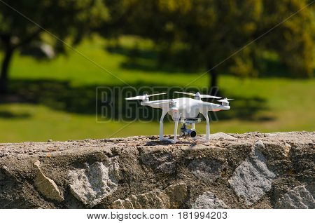 White Drone landed on a wall. Drone waiting for fly