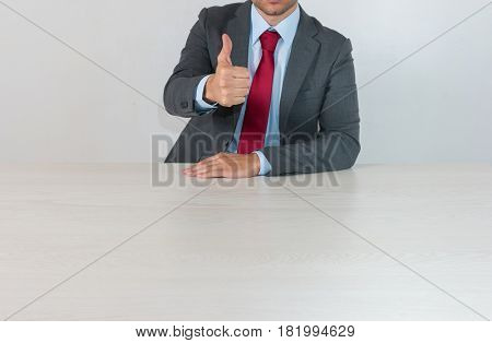 Businessman leaning on an empty desk