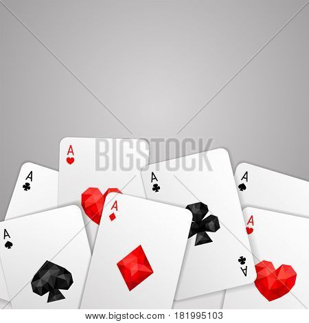 Background with four aces playing cards suits on gray. Copy space. Winning poker hand