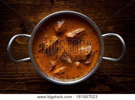 lamb tikka masala in balti dish flat lay compositon